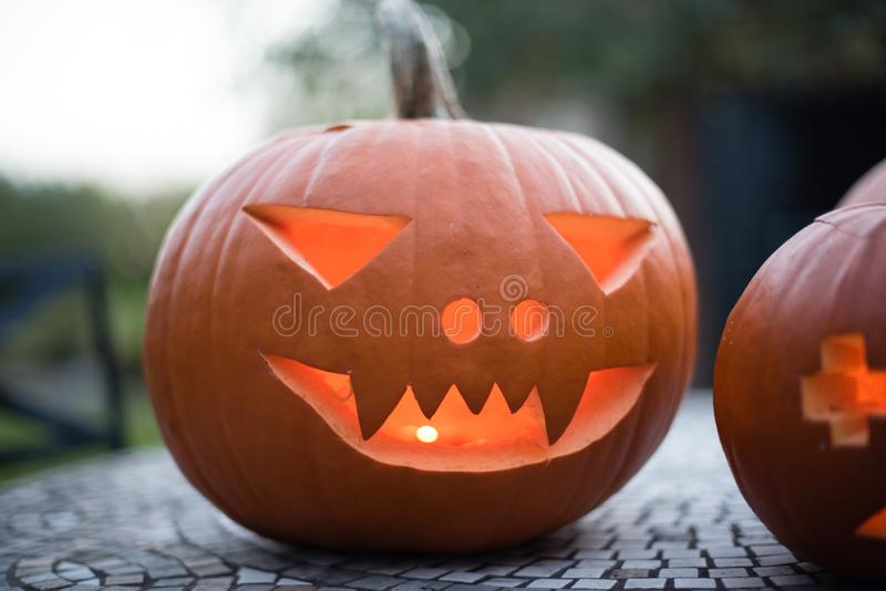A carved pumpkin ready to go on display at Halloween stock image
