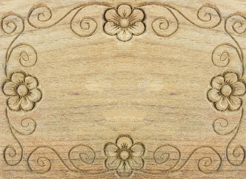 Carved Retro Floral Pattern as Frame on Wooden Background with Copyspace stock image