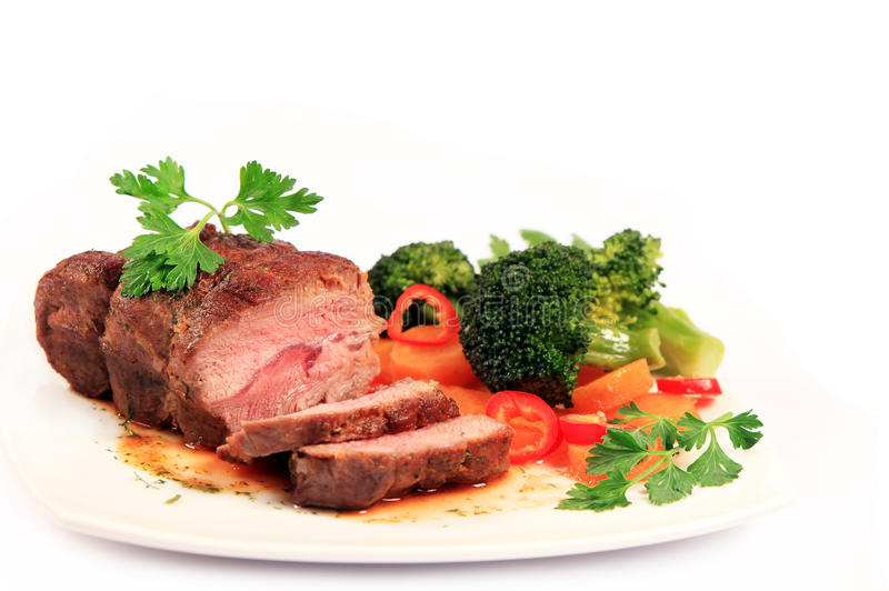 Carved roast beef and vegetables royalty free stock images