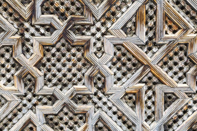 Carved Screen. Intricately carved wood uses Islamic geometric designs to create privacy in a madrassa in Fez, Morocco
