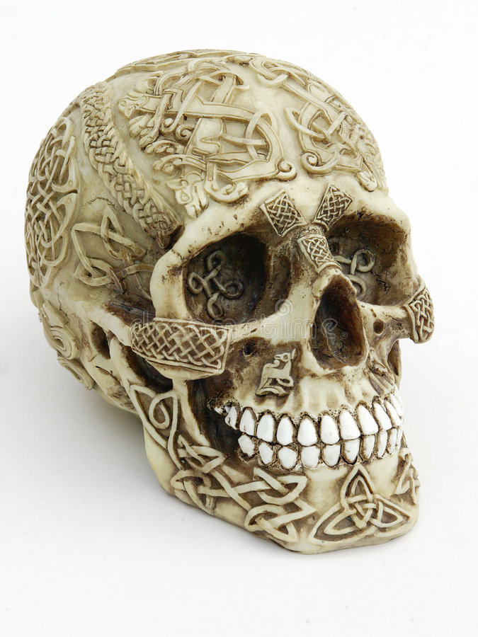 Carved Skull. Heavily carved human skull with celtic designs stock photos