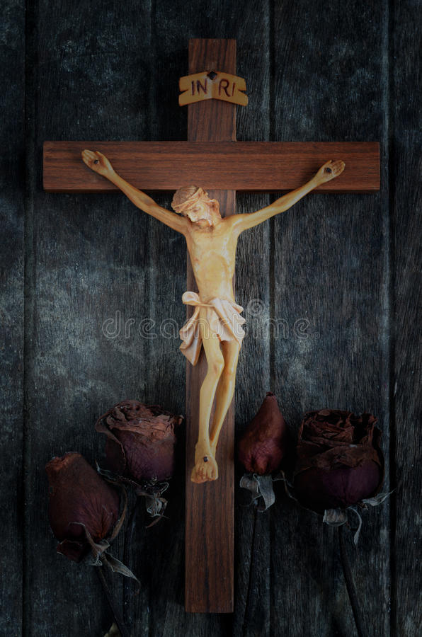 A carved statue of the Crucifixion of Jesus Christ stock photography