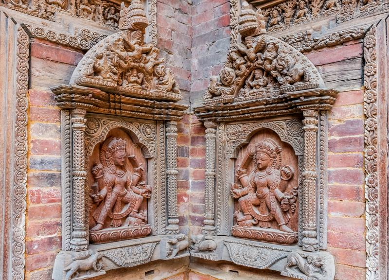 Carved statues on Mul Chowk courtyard wall, Hanuman Dhoka Royal Palace, Patan Durbar Square, Lalitpur, Nepal. Asia royalty free stock image