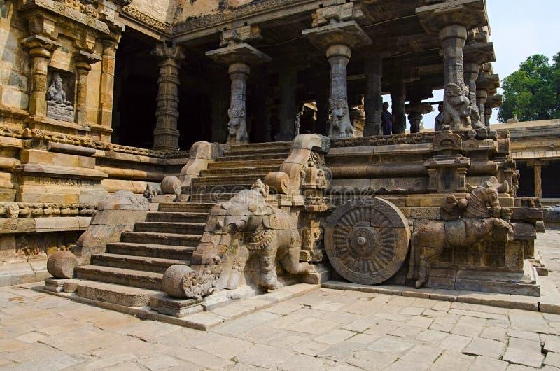 Carved stone chariot on the outer wall of Airavatesvara Temple, Darasuram, near Kumbakonam, Tamil Nadu, India. Carved chariot on the outer wall of Airavatesvara royalty free stock photography