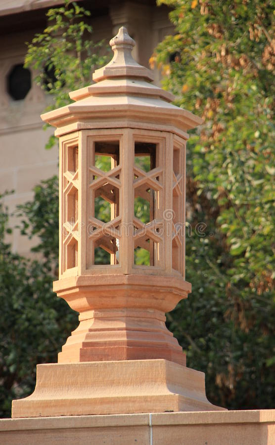 Carved Stone Lamp Post. Lamp post carved in stone on the compound of Umaid Bhavan Palace, Jodhpur, Rajasthan, India, Asia stock images