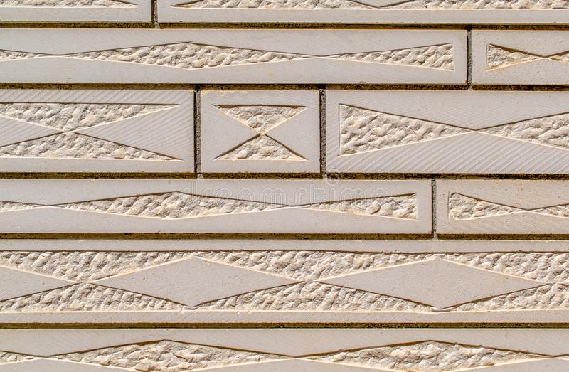 Carved stone wall cladding. Wall background image. stock photo