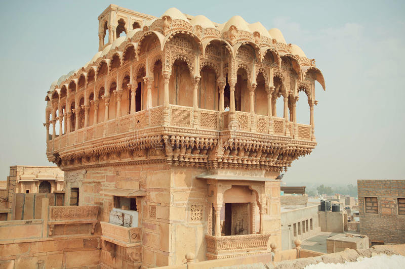 Carved tower with stone balconies of ancient indian house