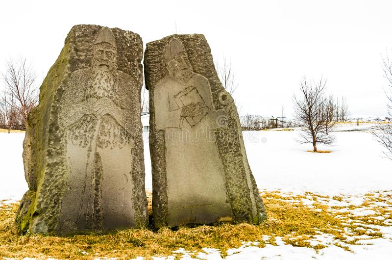 Carved viking priests statues near Skalholt Cathedral, Iceland stock photo
