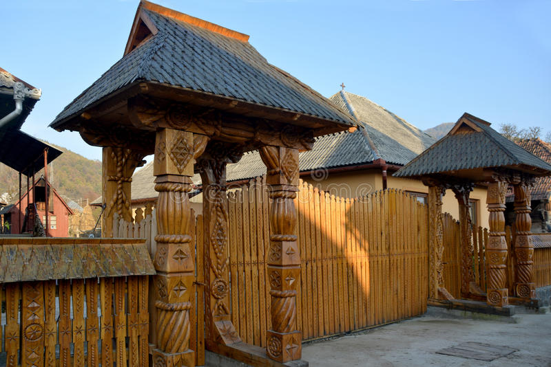 Carved wood gate. Such carved wood gate is traditional for Maramuresh region (Romania). Beauty and large gate is lucky charm of family welfare stock image
