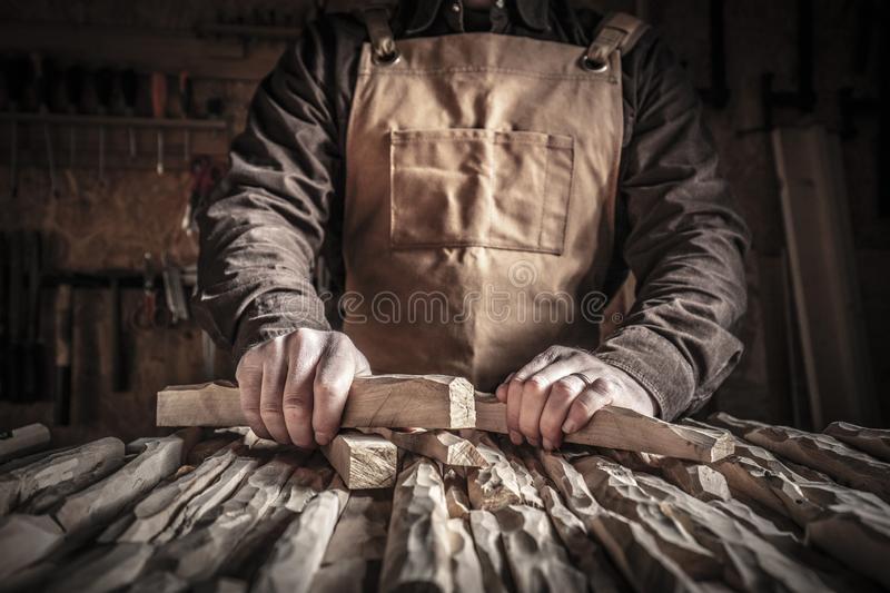 Carved wood in hands. Detail of carpenter holding carved wood stock image