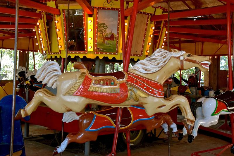 Carved wood horse on a carrousel. ROLLAG, MINNESOTA, Sept 3. 2017: A An old carrousel with wood carved and painted horses provide rides at the annual WCSTR farm stock photos