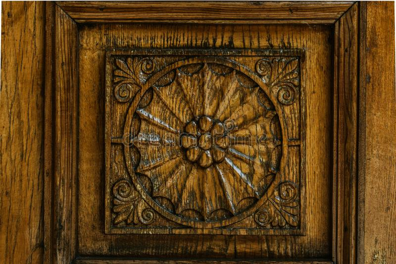 Carved wood pattern, retro element of decor. Exquisite wood carving technology stock images