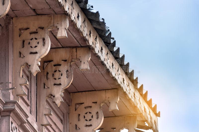 Carved wood roof houses, rustic stock photography