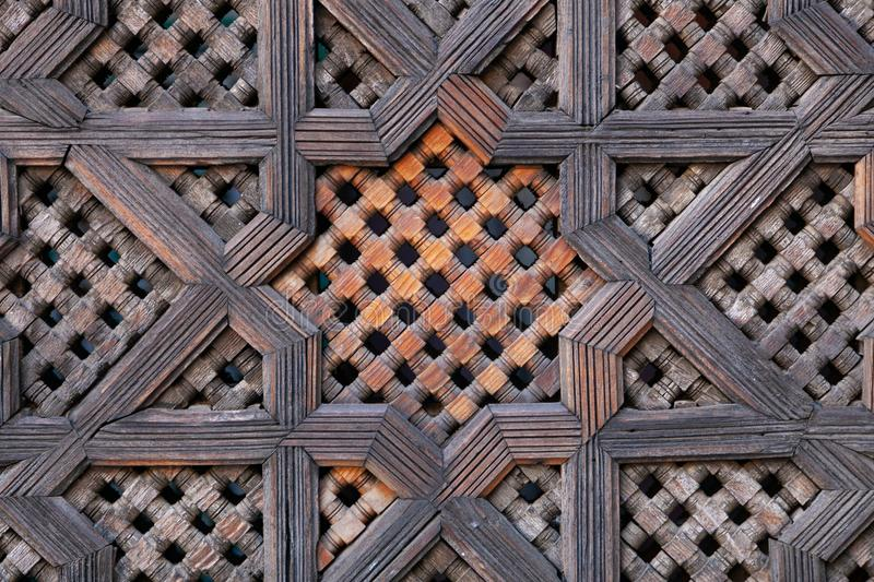 Carved wood screen in Morocco. An intricately carved wood screen in Morocco royalty free stock images