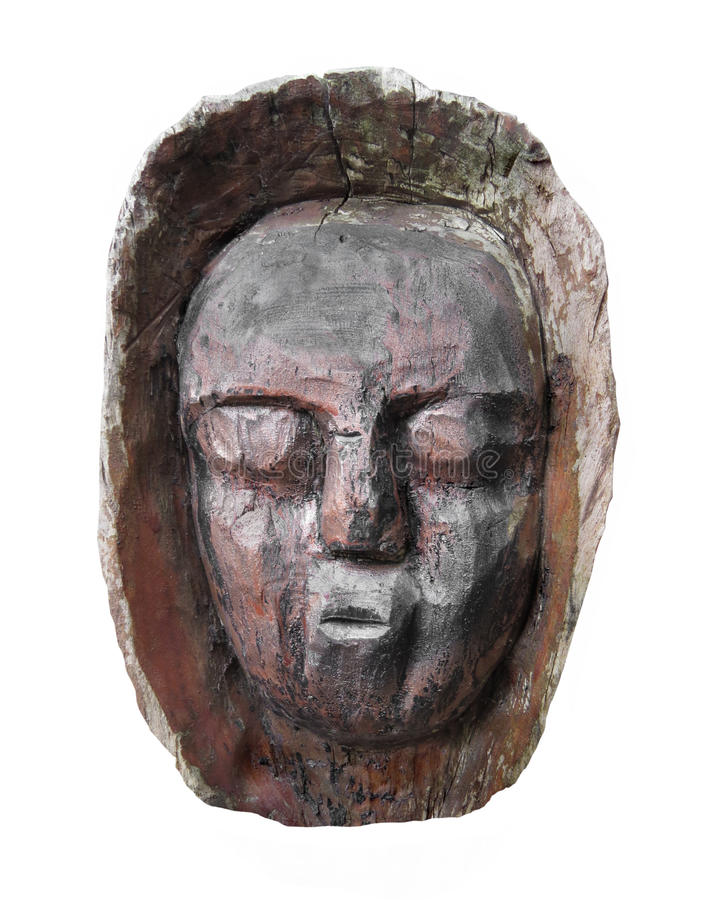 Carved wooden face isolated. royalty free stock images