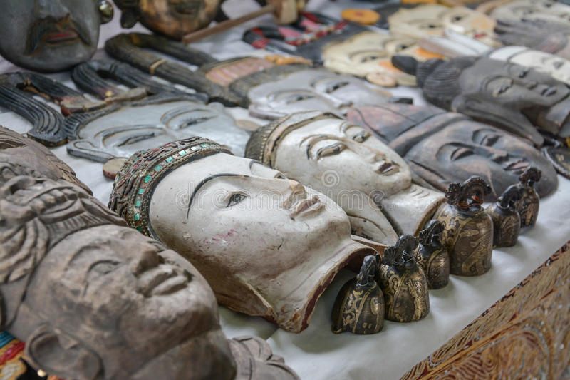 Carved wooden faces of Myanmar kings and ancient people. Myanmar royalty free stock photo