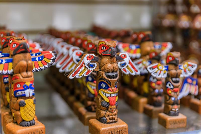 Carved wooden First Nations Native American Indian totem pole souvenirs at a tourist shop in Vancouver Canada royalty free stock photo