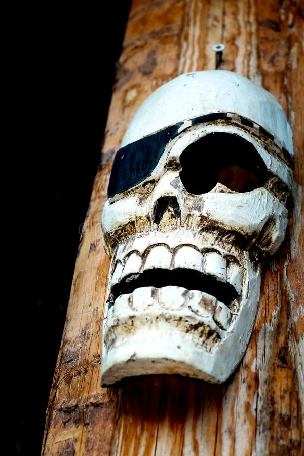 Carved wooden skull head royalty free stock image