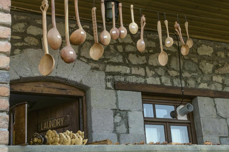 Carved wooden souvenirs, spoons and toys on the veranda with brick columns on Sharambeyan street in Tufenkian Museum Old Dilijan royalty free stock photography