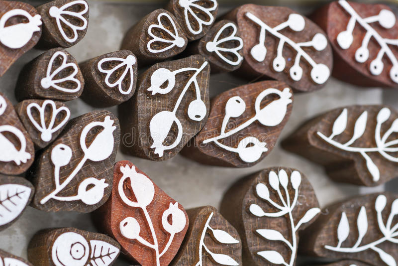 Carved wooden stamps of various designs stock images