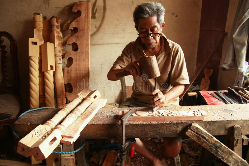 Old Man The Carver Gamelan. A carver is finishing a gamelan Gong Home Factory, Bogor, West Java, Indonesia royalty free stock photos