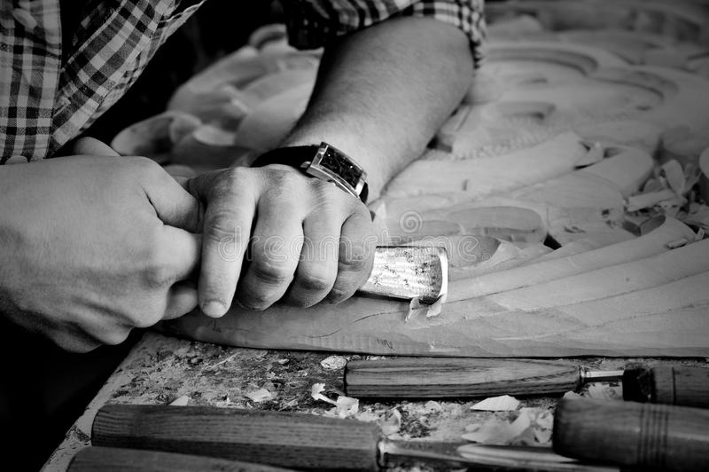 Carvers Hands work with chisel in workshop. Monochrome carvers Hands work with chisel in workshop stock images