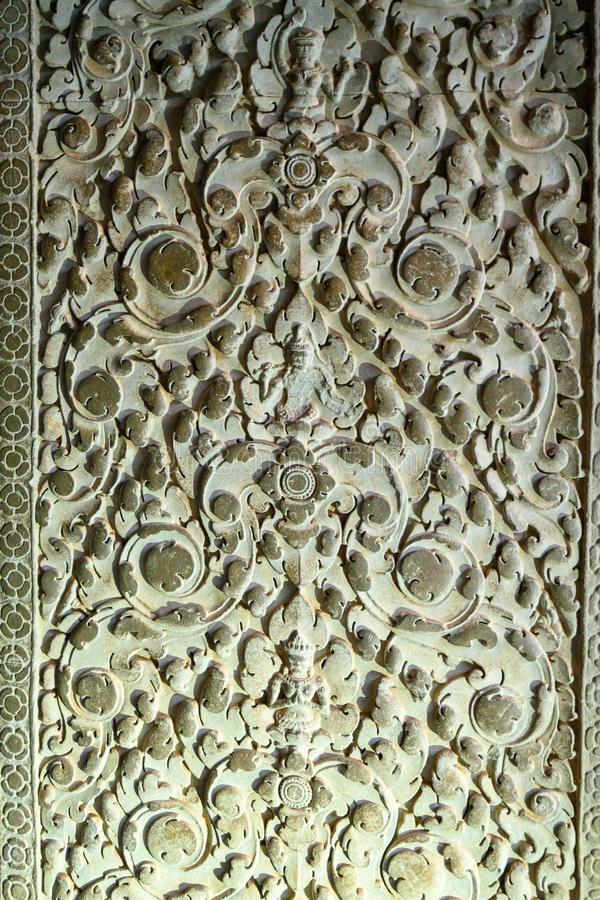 Relief - carved stones in Angkor Wat, Khmer Temple, Siem Reap, Cambodia. Carved stones in Ankor Wat, the largest Hindu Temple in the world. Angkor Wat built in royalty free stock image