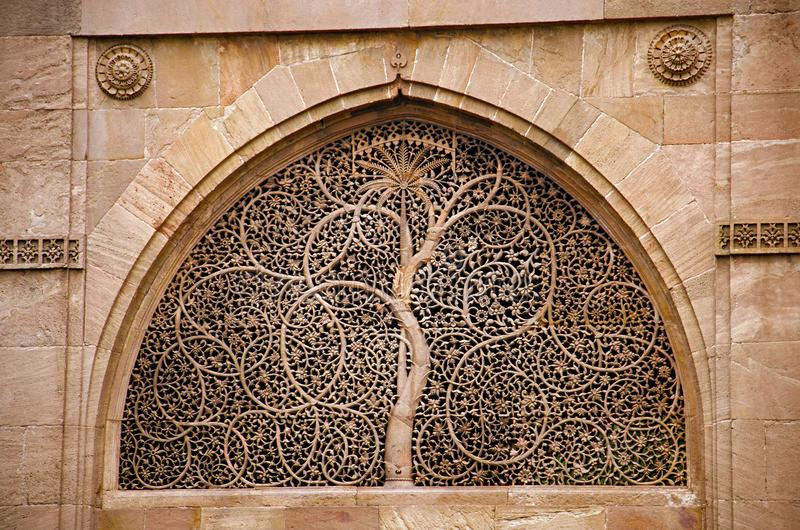 Carving details on the outer wall of the Sidi Sayeed Ki Jaali Mosque, Built in 1573, Ahmedabad, Gujarat. India stock photography