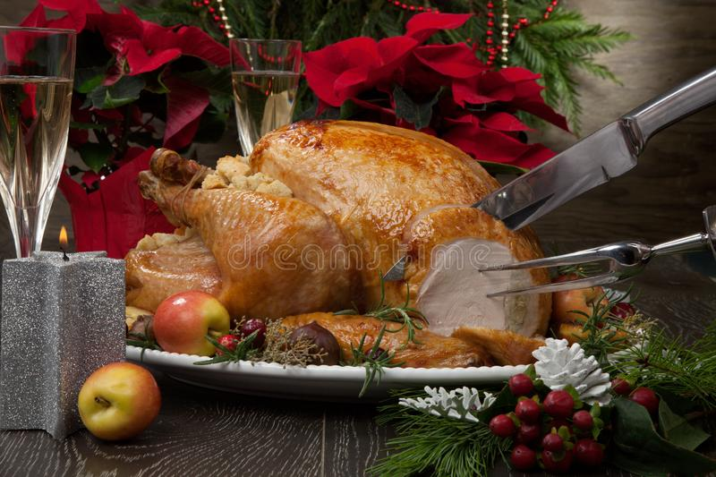 Carving Roasted Christmas Turkey with Grab Apples royalty free stock photos