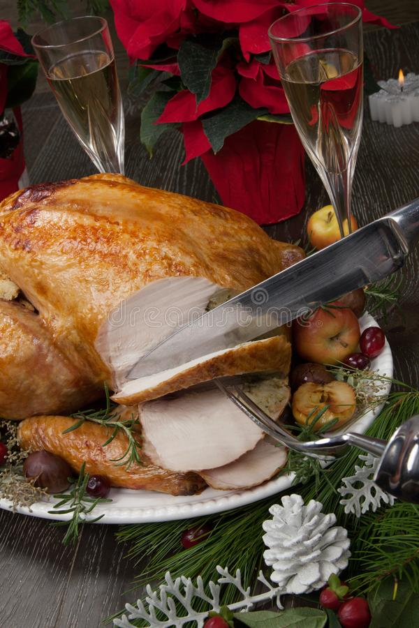 Carving Roasted Christmas Turkey with Grab Apples stock photo