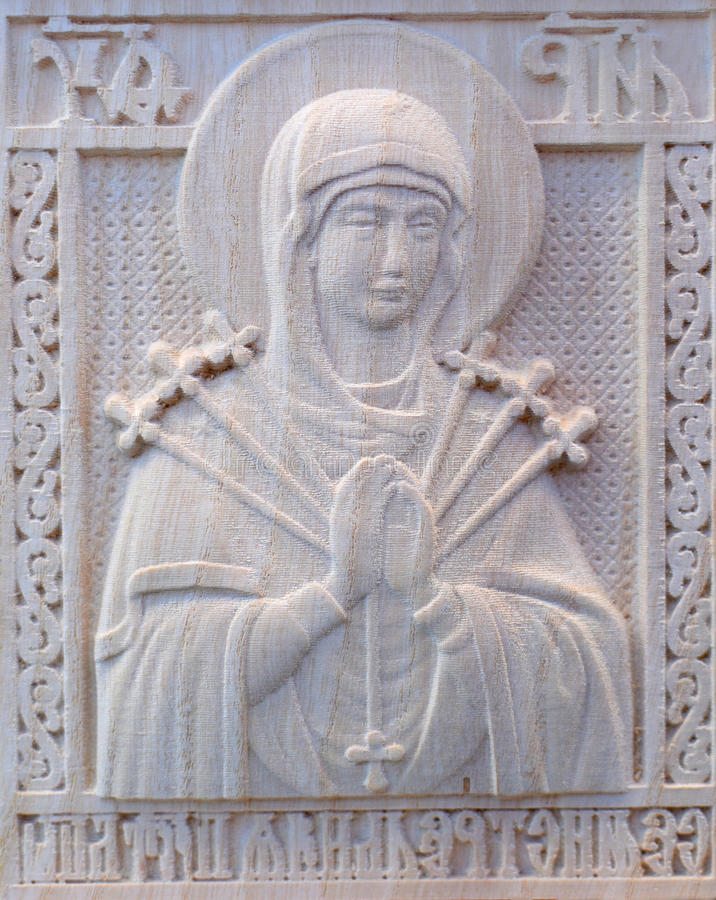 Carving on the machine with numerical control. Cut cutter machine icon of the Virgin Mary stock photography