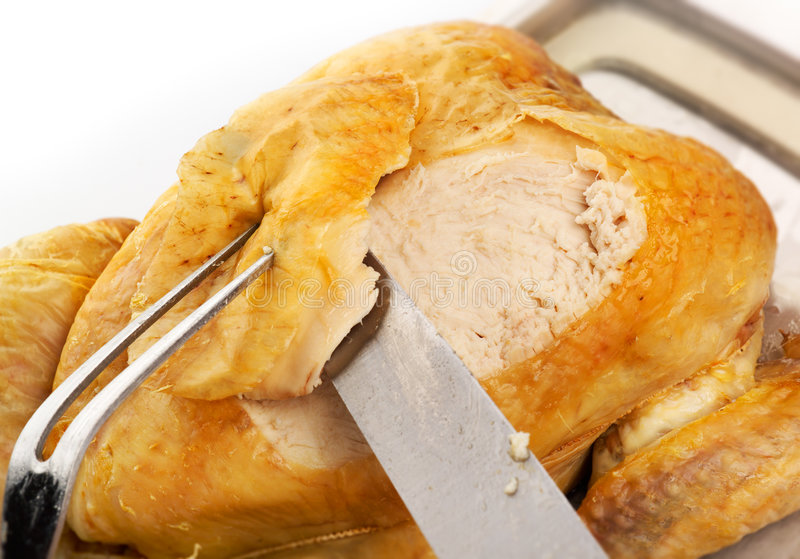 Carving Roast Chicken royalty free stock image