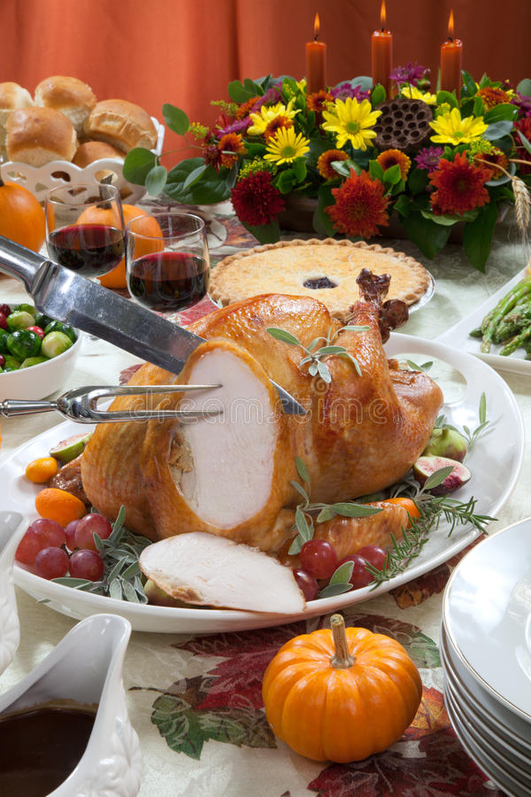 Carving Roasted Turkey on Harvest Table stock photography