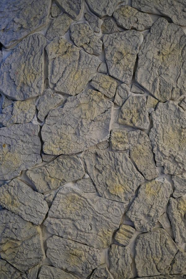 Carving rocks background. Close up carving rocks wall background royalty free stock image