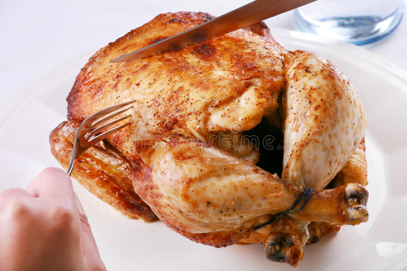 Carving Rotisserie chicken royalty free stock photo