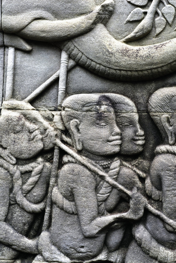Carving on the walls of Angkor Thom stock photography