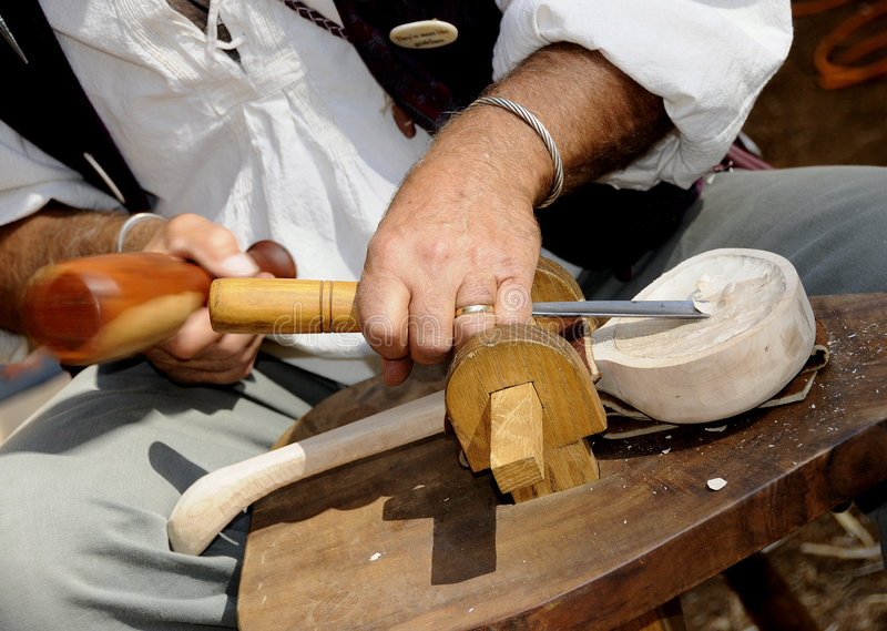 Carving Wood Spoon. The Old-Fashion Way at Renaissance Festival Faire royalty free stock images