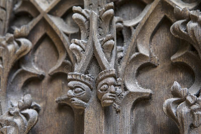 Carvings on the Doors of Coventry Cathedral royalty free stock image