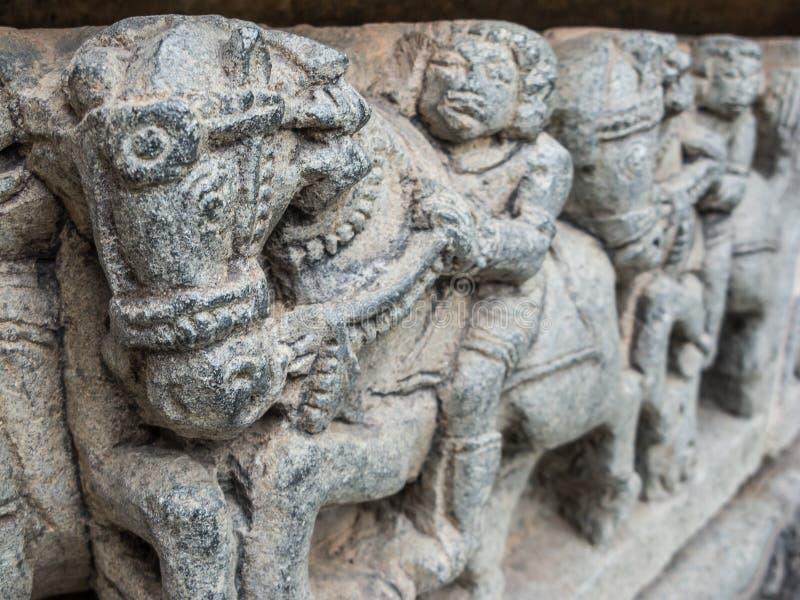 Carvings at Somanathapur. Carving of men riding horses at the temple of Somanathapur stock photography