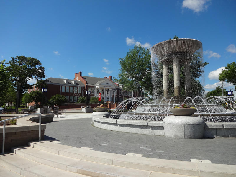 Cary, North Carolina Park and Art Center. Park in Downtown Cary, NC with Cary Art Center in the Background and a Running Fountain in the Foreground royalty free stock images