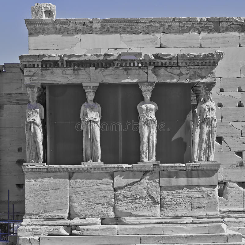 Caryatids in b/w and blue, erechtheion temple Acropolis. Athens Greece stock image