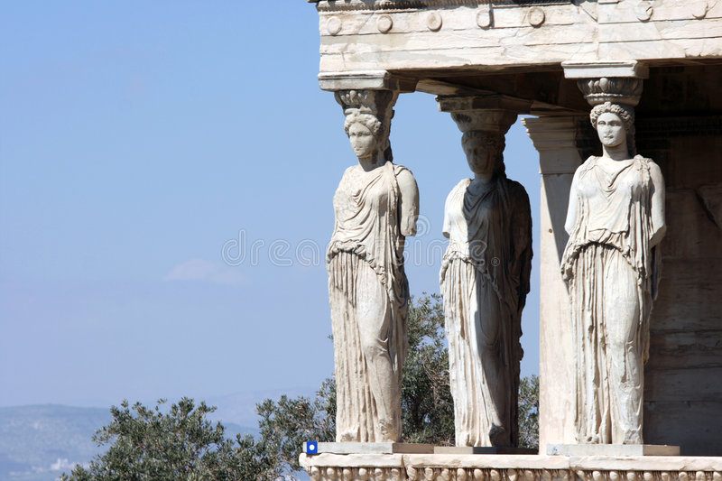 Caryatids copy space. Caryatids and nature at Erechtheum on Parthenon in Athens, Greece royalty free stock image