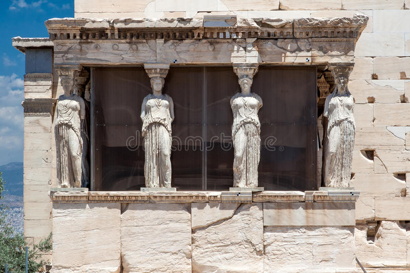 Caryatids Erechteion Acropolis Athens Greece. The Caryatids female statues with veils in the Erechteion temple ruins, Acropolis, Athens, Greece royalty free stock images