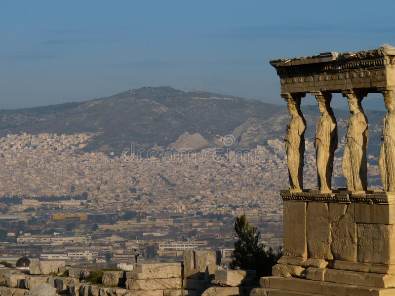 The Caryatids from the Erechteum temple, Acropolis, Athens, Greece. Zoom on the caryatids statues of the Erechteum temple, Acropolis, Athens, Greece royalty free stock photography