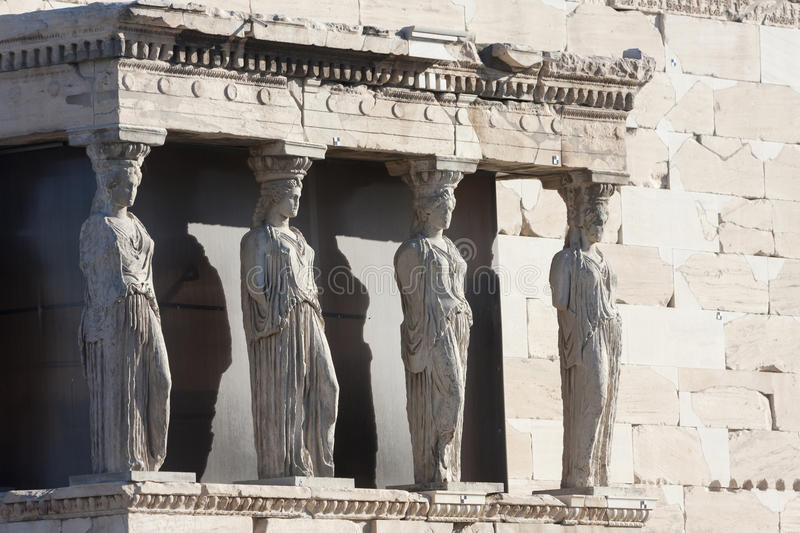 Caryatids in Erechtheion of Erechtheum. The caryatids in the Erechtheion of Erechtheum, the ancient greek temple in the Acropolis of Athens in Athens, Greece stock photo