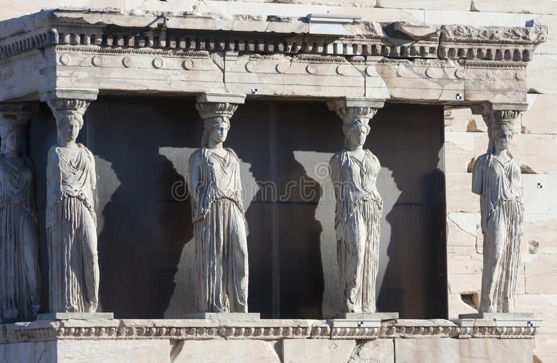 Caryatids on Erechtheion of Erechtheum in Athens. The caryatids in the Erechtheion of Erechtheum, the ancient greek temple in the Acropolis of Athens in Athens stock images