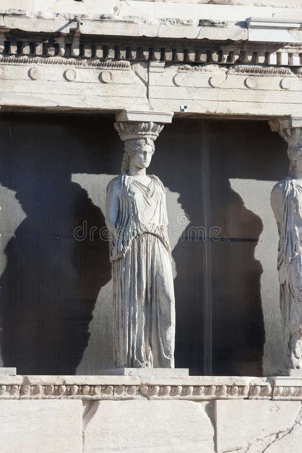 Caryatids on Erechtheion temple in Athens. The caryatids in the Erechtheion of Erechtheum, the ancient greek temple in the Acropolis of Athens in Athens, Greece stock photography