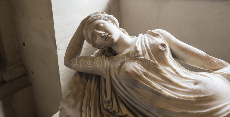 The Caryatids room, The Louvre, Paris, France. A view in PARIS, FRANCE, MARCH 13, 2017 : architectural details of the caryatids room, the Louvre palace, march 13 royalty free stock images