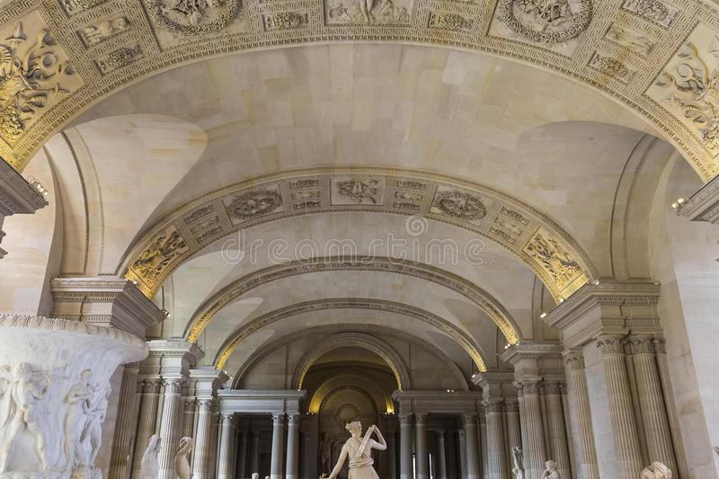 The Caryatids room, The Louvre, Paris, France. A view in PARIS, FRANCE, MARCH 13, 2017 : architectural details of the caryatids room, the Louvre palace, march 13 royalty free stock photo
