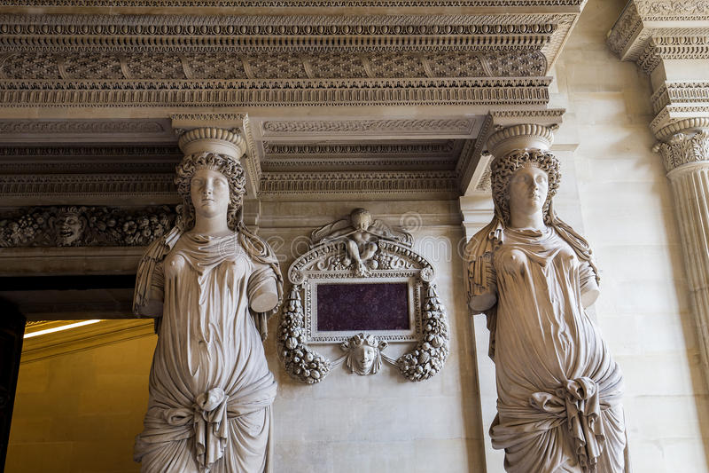 The Caryatids room, The Louvre, Paris, France. A view in PARIS, FRANCE, MARCH 13, 2017 : architectural details of the caryatids room, the Louvre palace, march 13 stock photos